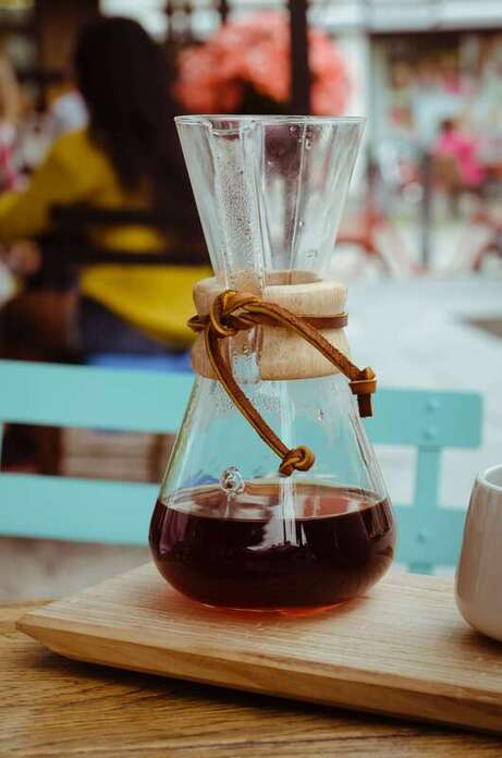 clear chemex containing coffee